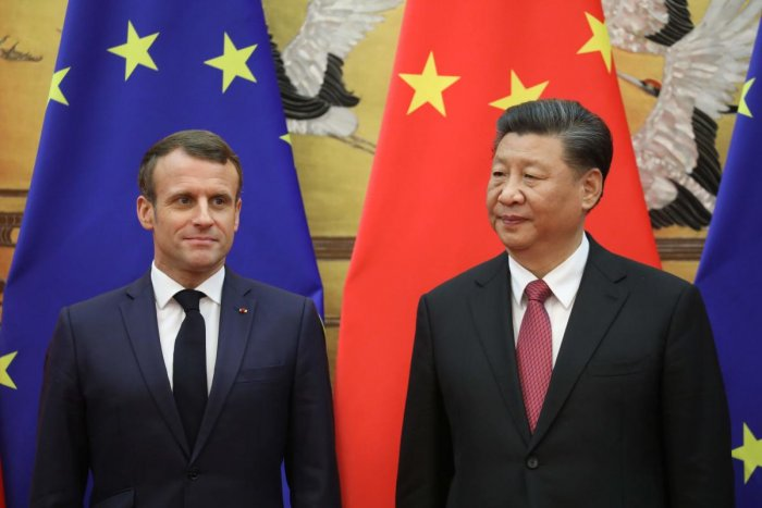 French President Emmanuel Macron (L) attends a signing ceremony with Chinese President Xi Jinping at the Great Hall of the People in Beijing on November 6, 2019. (Photo by LUDOVIC MARIN / AFP)
