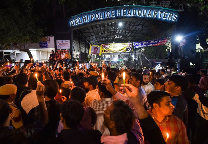 Delhi Police personnel hold a candle light protest at Delhi Police Headquarters over alleged repeated incidents of violence against them by lawyers, in New Delhi, Tuesday, Nov. 5, 2019. (PTI Photo/Manvender Vashist)
