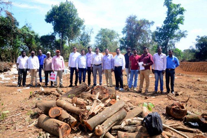 Vishva Hindu Parishad and Bajrang Dal leaders visit the Hindu burial ground in Bethu village in Napoklu on Monday.