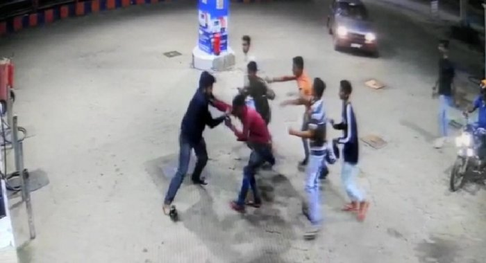 The CCTV video grab which shows the youth assaulting petrol bunk personnel in Baichanahalli on Monday night.