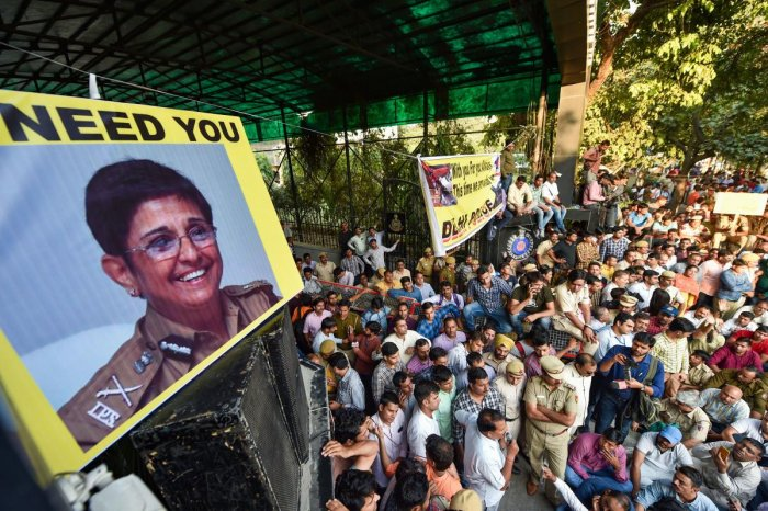 Delhi Police personnel display pictures of former IPS officer Kiran Bedi during a protest against the repeated incidents of alleged violence against them by lawyers including the Tis Hazari Court clashes, in New Delhi on Tuesday. (PTI Photo)