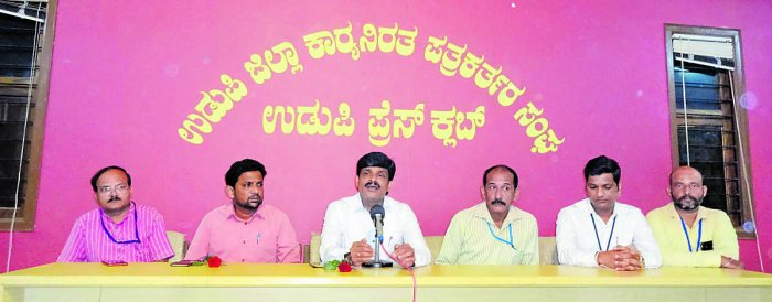 Deputy Commissioner G Jagadeesha speaks at an interaction organised by Working Journalists' Association in Udupi on Tuesday.