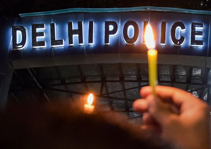 Delhi Police personnel hold a candle light protest at Delhi Police Headquarters over alleged repeated incidents of violence against them by lawyers, in New Delhi on Tuesday. (PTI File Photo)