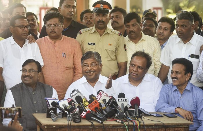 Maharashtra BJP President Chandrakant Patil with party leaders Sudhir Mungantiwar, Ashish Shelar and Girish Mahajan interact with media after meeting Maharashtra Governor Bhagat Singh Koshyari, in Mumbai on Thursday. (PTI Photo)