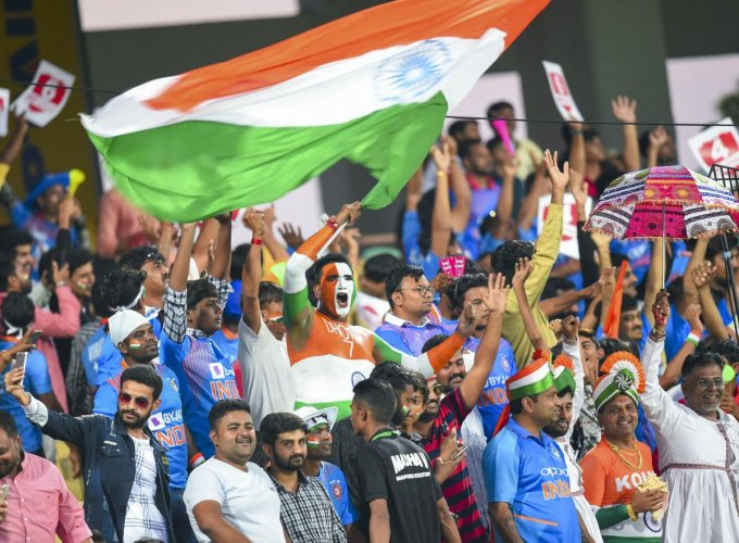 An Indian team fans cheers waving the tricolour during the second T20 cricket match between India and Bangladesh, at Saurashtra Cricket Association Stadium in Rajkot, Gujarat, Thursday, Nov. 7, 2019. (PTI Photo)