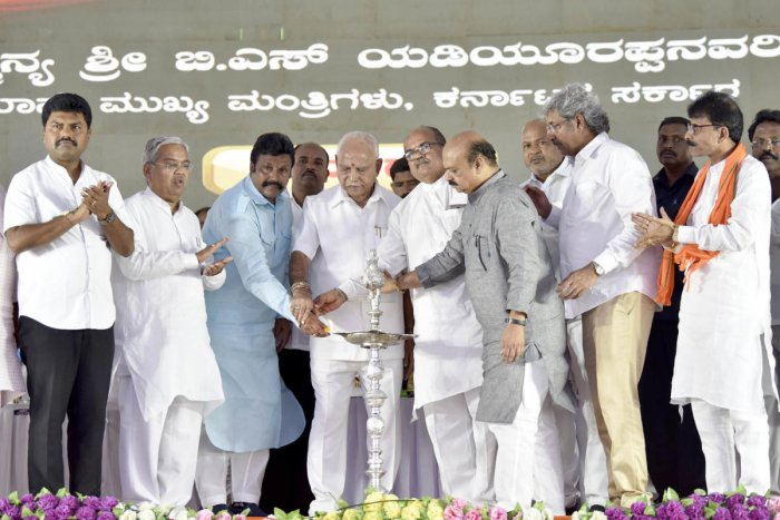 Chief Minister B S Yediyurappa, joined by disqualified Congress MLA B C Patil and BJP leader U B Banakar, inaugurates a programme in Hirekerur, Haveri district, on Thursday. Deputy Chief Minister Govind Karjol, Home Minister Basavaraj Bommai and others lo