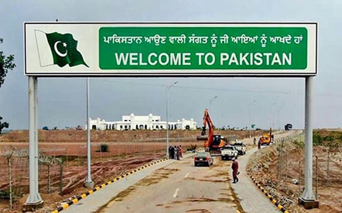 In this undated handout photo, a sign board reads, ' Welcome to Pakistan', against the backdrop of Gurdwara Kartarpur Sahib in Pakistan. PTI