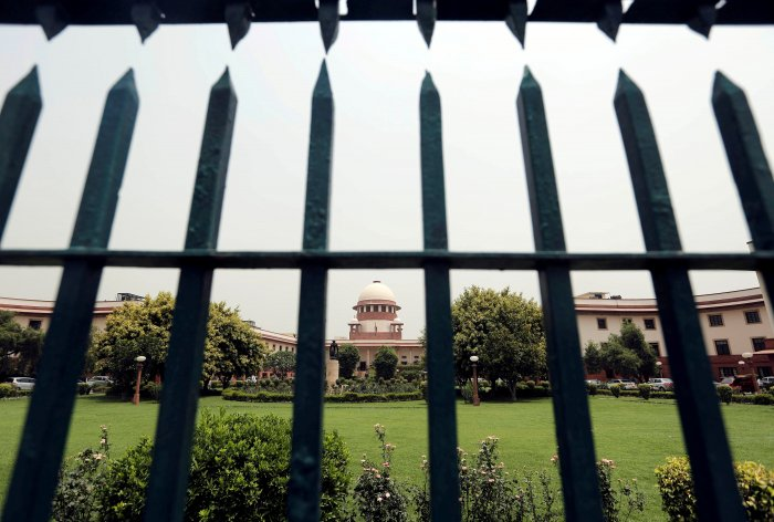 India's Supreme Court is pictured through a gate in New Delhi. (Reuters Photo)