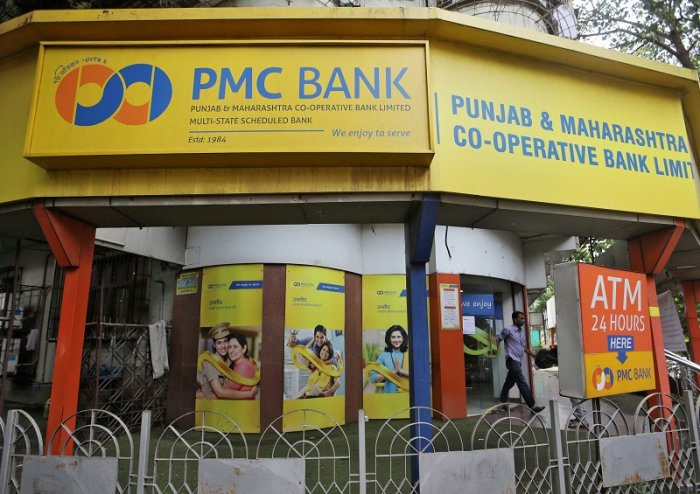 A man walks out from a PMC (Punjab and Maharashtra Co-operative) Bank branch in Mumbai, India. (Reuters Photo)