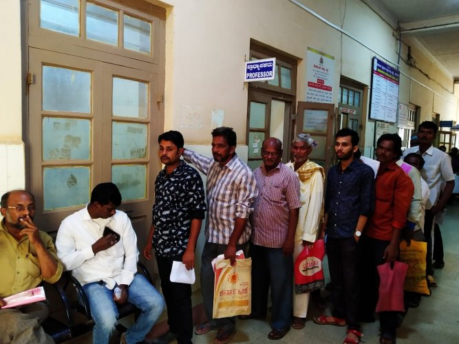 Long queue of patients at KIMS OPD section in Hubballi on Friday.