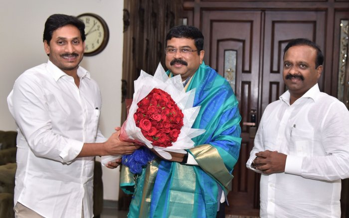 Union Petroleum and Natural Gas Minister Dharmendra Pradhan being presented with a bouquet by Andhra Pradesh Chief Minister YS Jaganmohan Reddy during a meeting, in Guntur (PTI Photo)