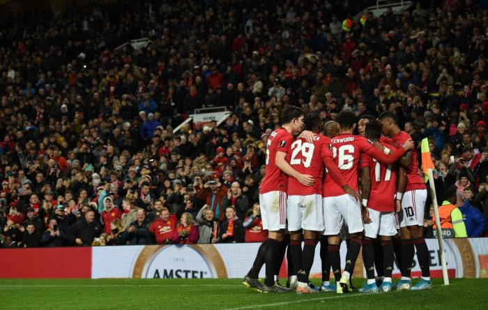Manchester United players celebrate Manchester United's French striker Anthony Martial goal during the UEFA Europa League Group L football match between Manchester United and Partizan Belgrade at Old Trafford in Manchester, north west England, on November 7, 2019. (AFP Photo)