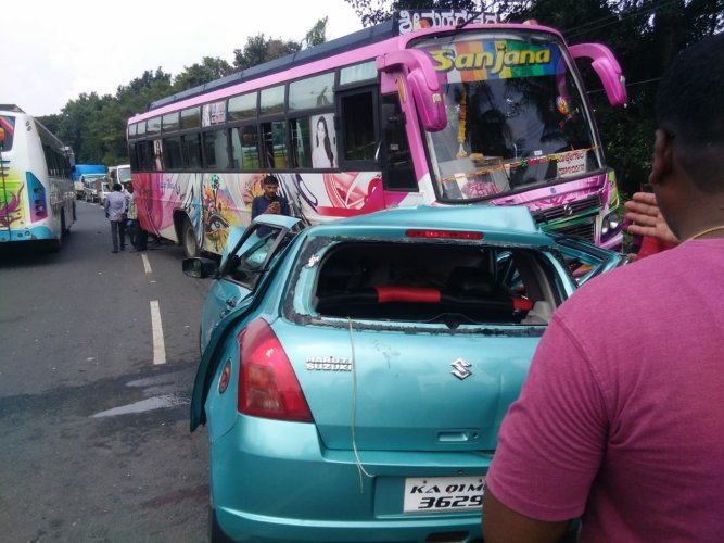 The car, which was heading towards Mysuru from T Narasipur, hit the bus coming from the opposite direction. (DH Photo)