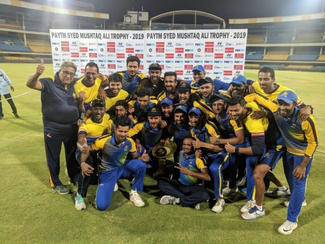 Karnataka players celebrate with the Syed Mushtaq Ali Trophy at the Holkar stadium in Indore in March, 2019.