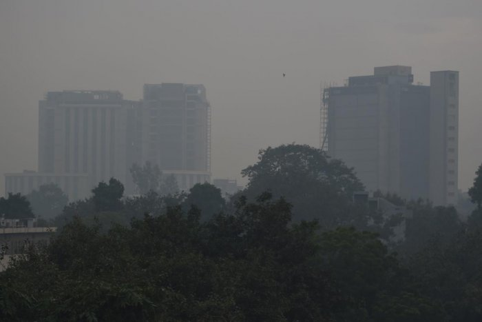 Buildings are seen covered in thick smog in New Delhi on November 7, 2019. (Photo by AFP)