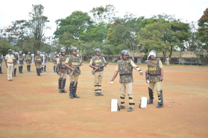 Police personnel engage in a mock exercise on security at police grounds in Madikeri. dh photo