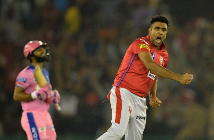 Ravichandran Ashwin (R) bowls for Kings XI Punjab against the Rajasthan Royals during the 2019 Indian Premier League. Credit: Sajjad Hussain/AFP