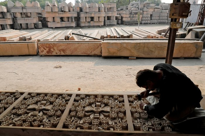 A worker engraves a stone that Hindu groups say will be used to build a Ram temple at a disputed religious site in Ayodhya in the northern state of Uttar Pradesh. (Reuters Photo)