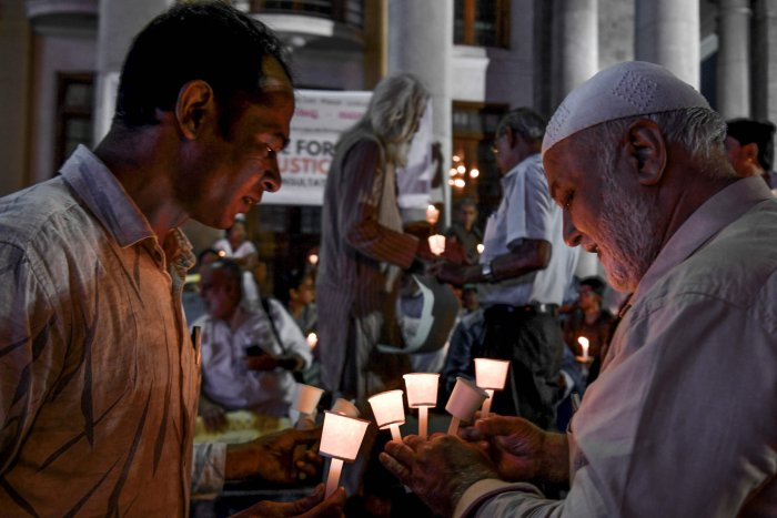 Activists belonging to 'People for Peace and Justice' stage a candle light vigil urging people belonging to all religious communities to maintain peace and harmony regardless of the outcome of the Supreme Court verdict on Ayodhya's Ram Janmabhoomi case. (AFP Photo)