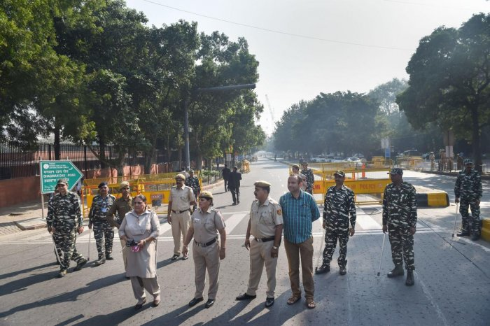 Police personnel stand guard outside the Supreme Court, in New Delhi, Saturday, Nov. 9, 2019. Security around the apex court has been beefed up ahead of Ayodhya verdict. (PTI Photo/Manvender Vashist)