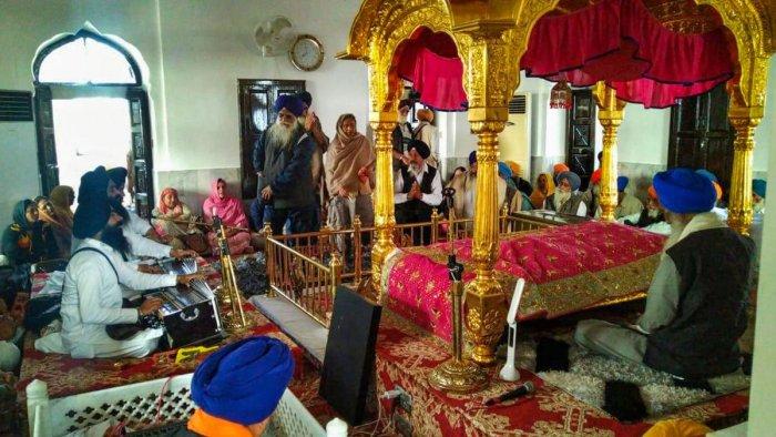 Devotees offers prayer at Gurdwara Kartarpur Sahib in Pakistan. (PTI Photo)