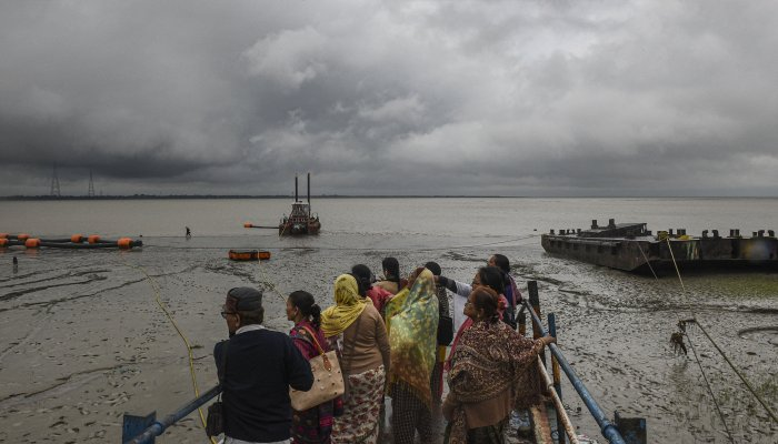 Villagers look into the sea in the wake of the very severe cyclonic storm 'Bulbul', which is likely to make landfall between West Bengal-Bangladesh coasts by late November 9 evening or night, at Kakdwip in South 24 Parganas. (PTI Photo)