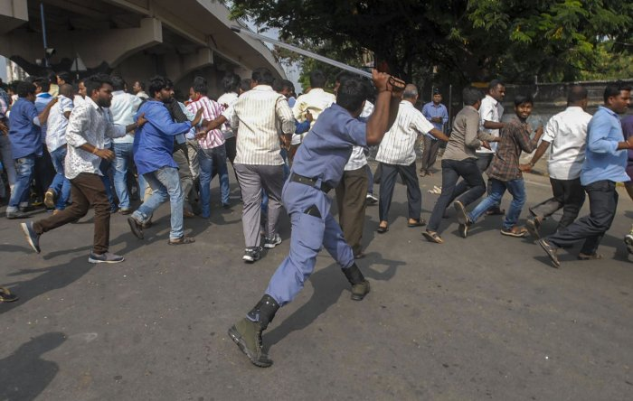 Police personnel baton charge protestors during a demonstration, in Hyderabad. (PTI Photo)