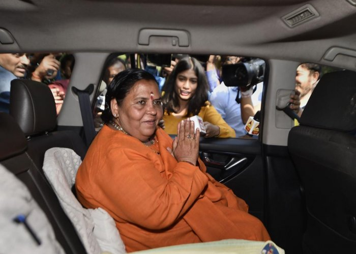 Senior BJP leader Uma Bharti leaves after meeting party veteran LK Advani at his residence, in New Delhi, Saturday, Nov. 9, 2019. (PTI Photo)