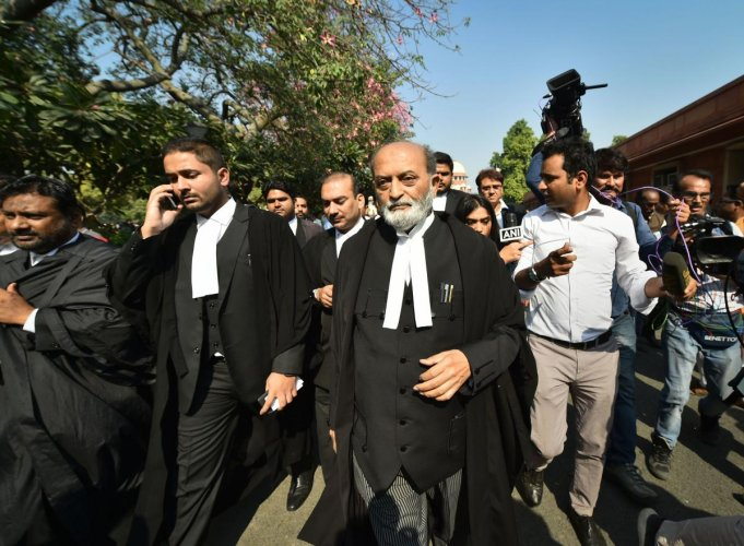 Sunni Waqf Board lawyer Zafaryab Jilani along with other advocates comes out of the Supreme Court after the Ayodhya case verdict, in New Delhi, Saturday, Nov. 9, 2019. (PTI Photo/Arun Sharma)