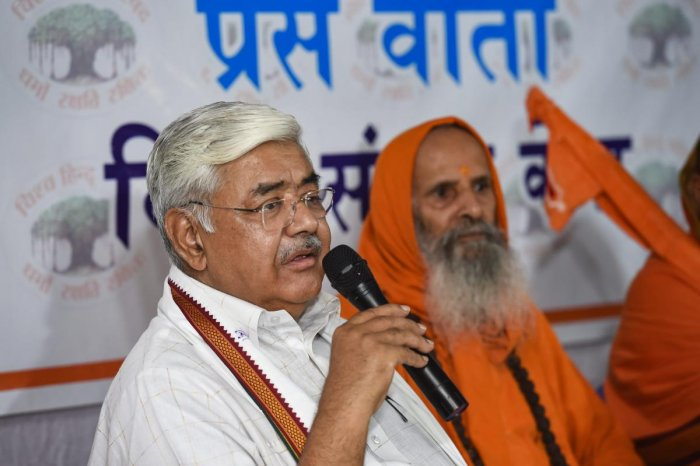 VHP working president Alok Kumar addresses a press conference as spiritual leader Swami Parmanand looks on, in New Delhi on Friday. PTI