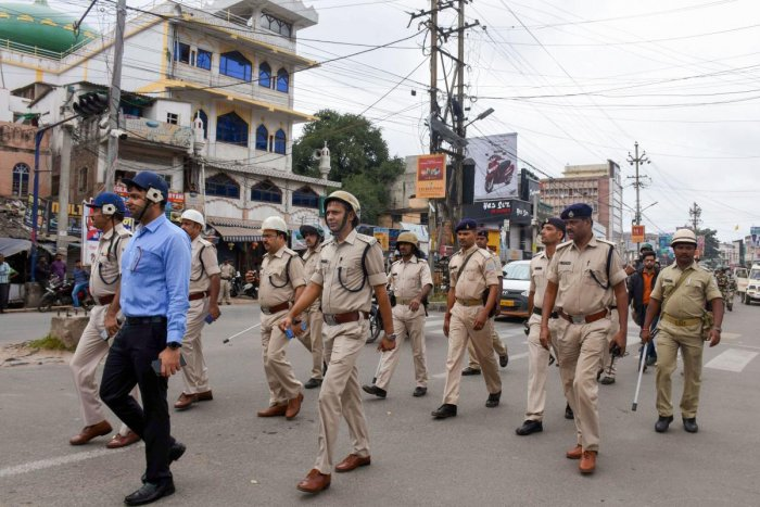 Police personnel patrol in a sensitive area as security has been tightened in the view of the Ayodhya case verdict, in Ranchi, Saturday, Nov. 9, 2019. (PTI Photo)