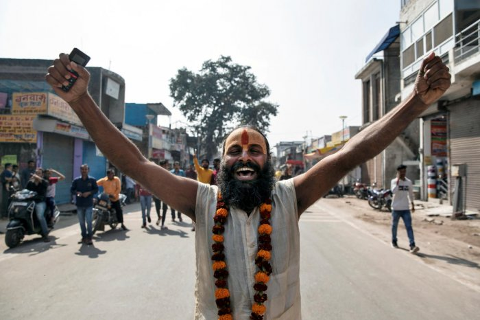 A Sadhu or a Hindu holy man celebrates after Supreme Court's verdict on a disputed religious site, in Ayodhya, India, November 9, 2019. (Reuters photo)