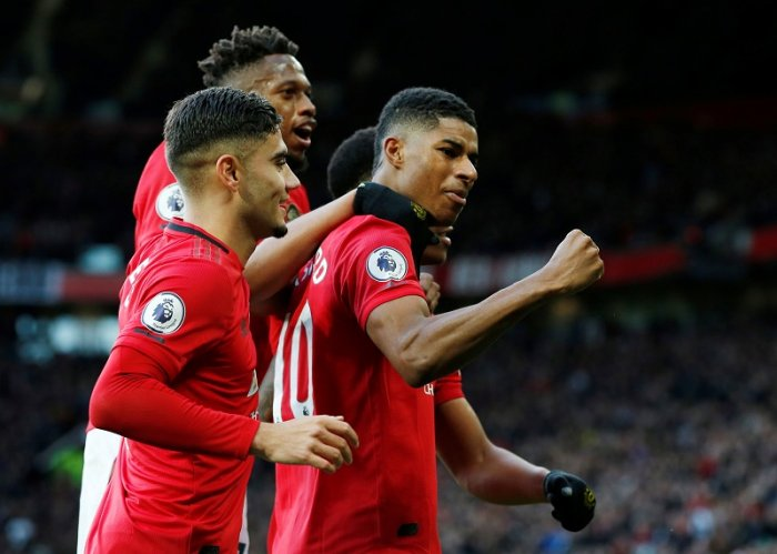 Manchester United's Marcus Rashford celebrates scoring their third goal with teammates. (Reuters Photo)