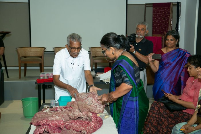 Dr Jeyraj (in white) shared tips on how to conserve handlooms at 'A Textile Conservation Workshop'.