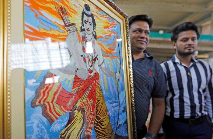 A man holds an image of Hindu Lord Ram during the news conference of Mohan Bhagwat, chief of the Hindu nationalist organisation Rashtriya Swayamsevak Sangh (RSS), in New Delhi, India November 9, 2019. (REUTERS)