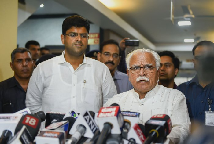 Haryana Chief Minister Manohar Lal Khattar speaks during a press conference after a meeting as Deputy Chief Minister Dushyant Chautala looks on, at Haryana Bhawan in New Delhi. (PTI Photo)