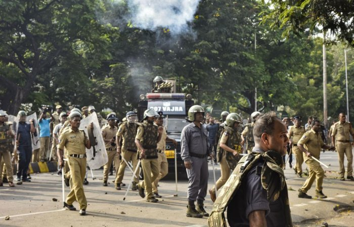 Security personnel lathi charge protesting TSRTC employees at Tankbund, in Hyderabad.(PTI Photo)