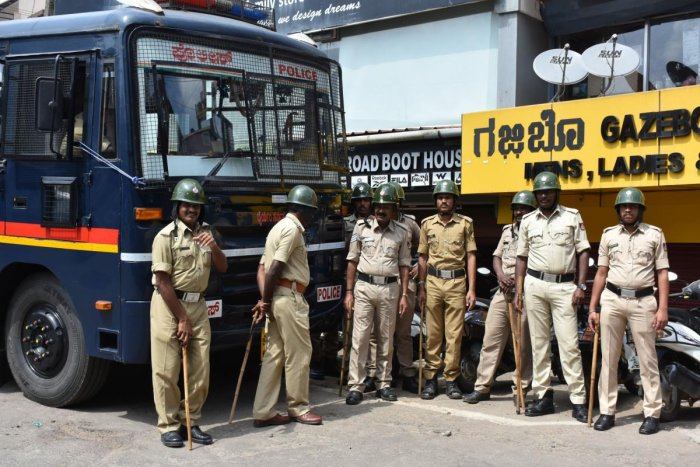Police personnel deployed at Indira Gandhi Circle, in Madikeri on Saturday. dh photo