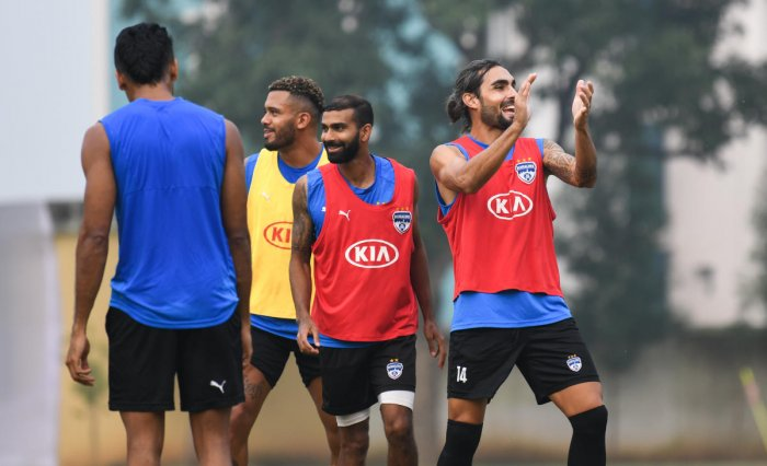 Bengaluru FC players share a light moment during a training session on the eve of their match against Chennaiyin FC in Bengaluru on Saturday. BFC MEDIA