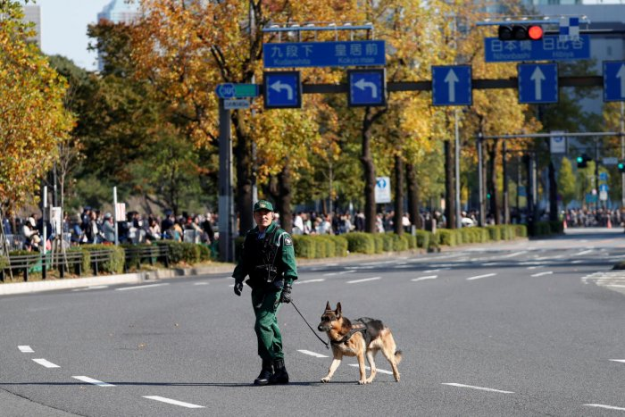 A police officer patrols with a police dog. (Photo: REUTERS)