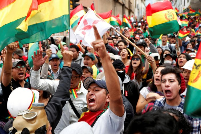 People shout slogans during a protest against Bolivia's President Evo Morales in La Paz (Reuters Photo)