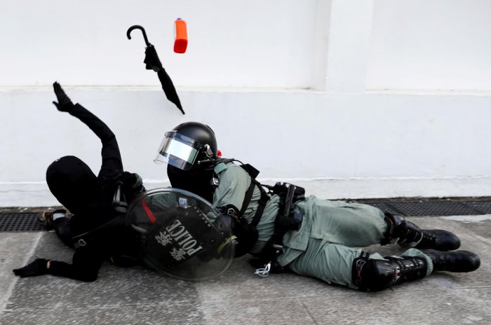 A riot police officer tries to subdue a protester during an anti-government demonstration in Hong Kong. (REUTERS)
