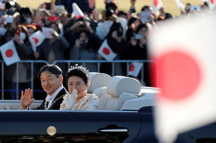 Japan's Emperor Naruhito and Empress Masako wave to well-wishers during their royal parade to mark the enthronement of Japanese Emperor Naruhito in Tokyo. Reuters