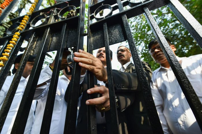 Advocates place a lock on the gate of Patiala Court during a protest over last week's incident of clashes between lawyers and police, in New Delhi, Wednesday, Nov. 6, 2019. (PTI Photo)