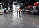 Heavy rains flood many city roads