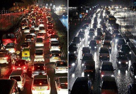 Surprise showers flood roads, leave commuters stranded