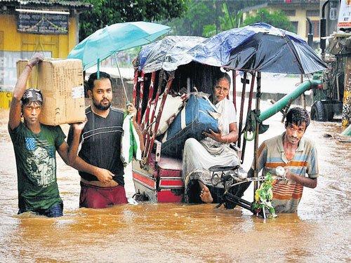 Assam flood scene turns critical, 2 killed