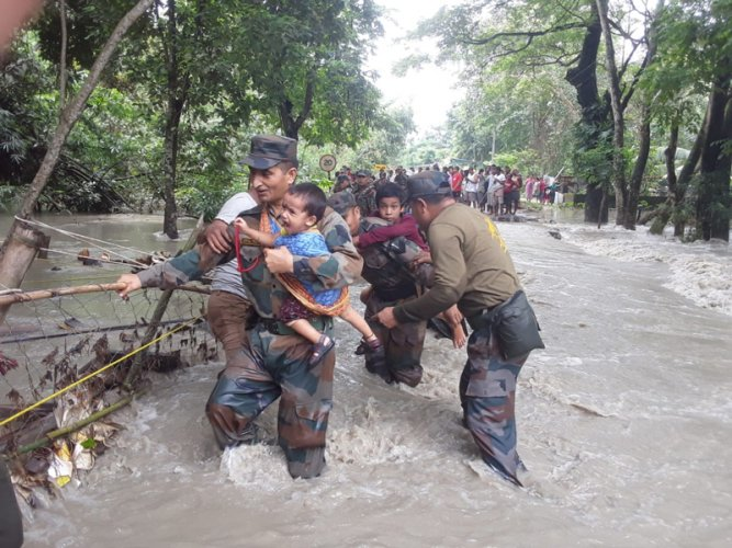 Army personnel rescuing flood hit people in Nalbari district in western Assam on Wednesday. (Photo credit: Army)