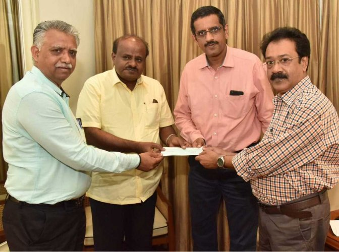 A cheque for Rs 46.46 lakh was on Wednesday handed over to Chief Minister H D Kumaraswamy towards the Chief Minister's Calamity Relief Fund on behalf of the Deccan Herald and Prajavani Relief Trust. DH photo