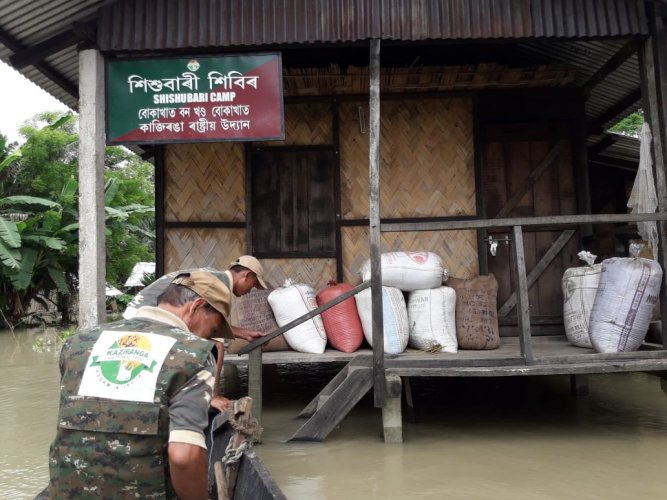Personnel of the rhino protection force in the flooded Kaziranga National Park in Assam on Saturday. Photo credit: Assam forest department.